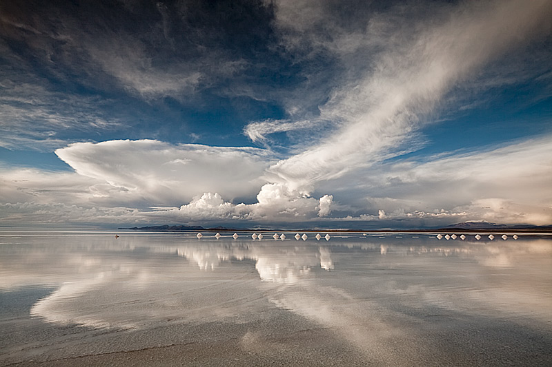 Salt-cones-and-cloud-reflections-on-shallow-water-covering-the-Salar-de-Uyuni-Bolivia-