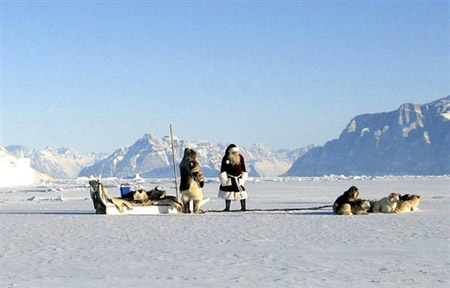 This undated recent picture shows two Santas with their spann of sledge dogs on the ice in Greenland. Which Santa is the right Santa, confused children ask as every Nordic country presents its unique Father Christmas, causing intense rivalry which does not always sit well with the kindness and nobility of spirit that kids expect of this mythical figure. Easy, say the Inuits, the indigenous population of Greenland: Since legend has it that Father Christmas lives somewhere near the North Pole, in the eternal glaciers, there can be no doubt that this is his home. Wherever children believe in Father Christmas, they imagine him to be unique, a single figure, majestically ruling over the kingdom of toys for the whole world. AFP PHOTO - Greenland Tourism Office