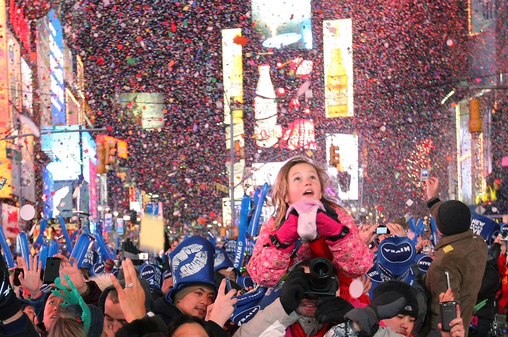 NEW YORK, NY - JANUARY 1: People celebrate as the stroke of midnight rings in the new year in Times Square on January 1, 2013 in New York City. Approximately one million people are expected to ring in the new year in Times Square. (Photo by Monika Graff/Getty Images)