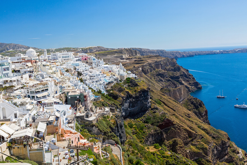 Greece, Santorini, Fira town. Morning view of the building and the Bay.